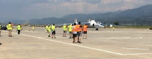 high-visibility-vests are requested on the apron. A shortage of vests can lead to collegues sharing one ;)