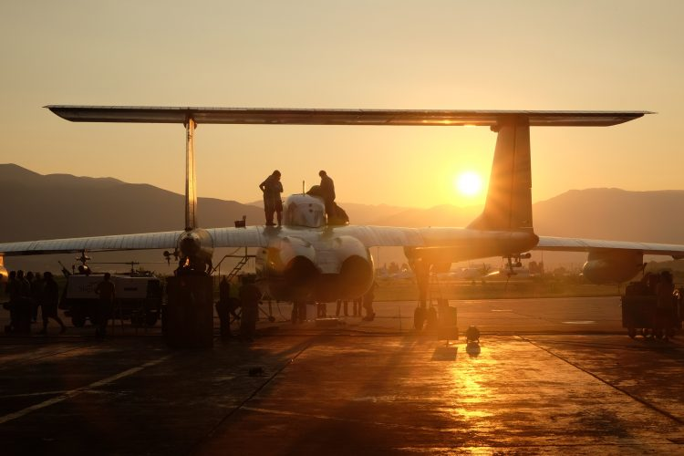 Last minute preparation before flight. Sunrise in the back. Picture by Brian Leen